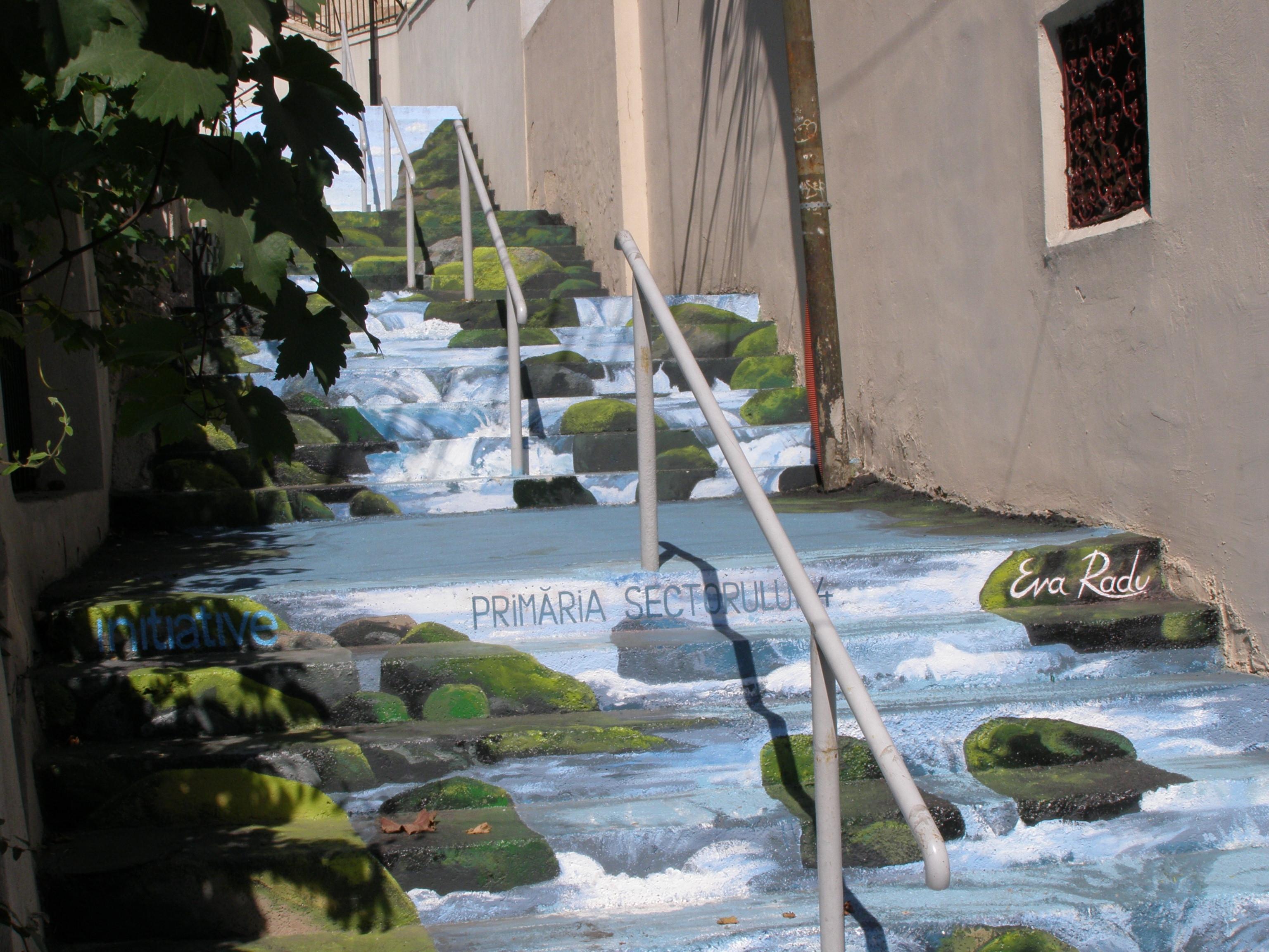 Un râu de munte îngust, care curge la vale, printre case, în plin centru Bucureştilor, la doi paşi de Parcul Carol şi Patriarhie. un rău pictat