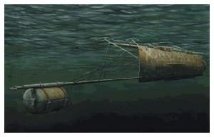 Torpila de şcondru cu care era înarmat Hunley: un butoi cu încărcătură explozivă, montat pe o bucată de catarg, în prelungirea provei